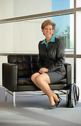 A businesswoman poses for an editorial photo shoot in Dallas, Texas as part of a cover story for Financial Advisor magazine.