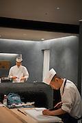 Chefs working at restaurant Kappou Ukai in Ginza, Tokyo