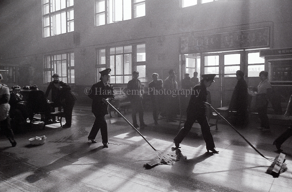 Attendants mopping the floor in Hohhot train station, Inner Mongolia, China, 1990