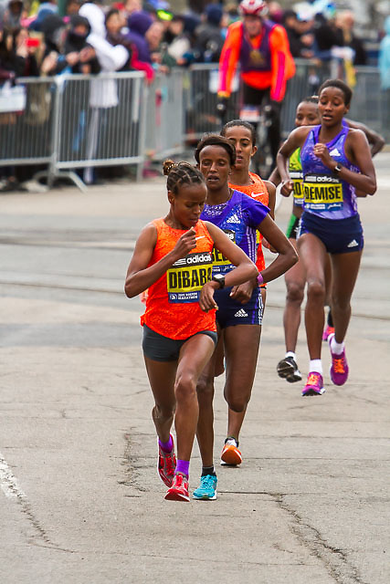 Mare Dibaba checks her watch as she surges to lead