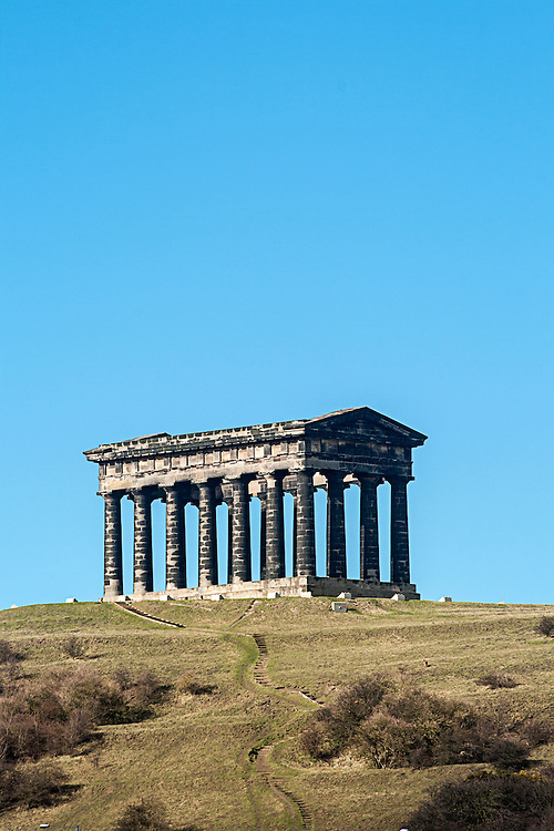 Penshaw Monument was built by local architects John and Benjamin Green and is a smaller copy of the Athenian Temple of Theseus - essentially a long and roofless Doric temple supported by pillars with no walls. The Grade 1 listed monument is one of the best known follies in the Northeast and is visible from miles around. Blackened with industrial soot from many previous colleries and factories, it was erected in 1844 as a memorial to John Lambton, 1st Earl of Durham.