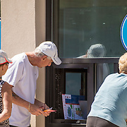 August 22, 2016, New Haven, Connecticut: <br /> Fans purchase tickets at the Dropbox during Day 4 of the 2016 Connecticut Open at the Yale University Tennis Center on Monday August  22, 2016 in New Haven, Connecticut. <br /> (Photo by Billie Weiss/Connecticut Open)