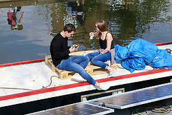 © Licensed to London News Pictures. 30/03/2019. London, UK. A couple enjoy the warm spring sunshine on a boat on on Regents Canal as warm weather across the UK continues. Photo credit: Dinendra Haria/LNP