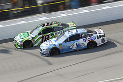 August 12, 2018 - Brooklyn, Michigan, United States of America - Kyle Busch (18) and Kevin Harvick (4) battle for position during the Consumers Energy 400 at Michigan International Speedway in Brooklyn, Michigan. (Credit Image: © Chris Owens Asp Inc/ASP via ZUMA Wire)