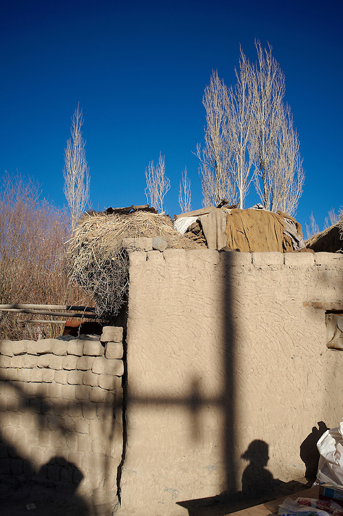 Shadow of a girl against a wall made of mud-bricks.<br />