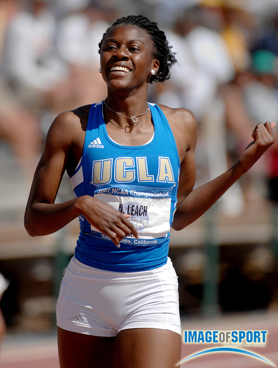 Nicole Leach of UCLA smiles after winning the women's 400 meters in a career-best 54.32 to move into third on the all-time Pacific-10 Conference list in the NCAA Track & Field Championships at Sacramento State's Hornet Stadium in Sacramento, Calif. on Saturday, June 9, 2007.