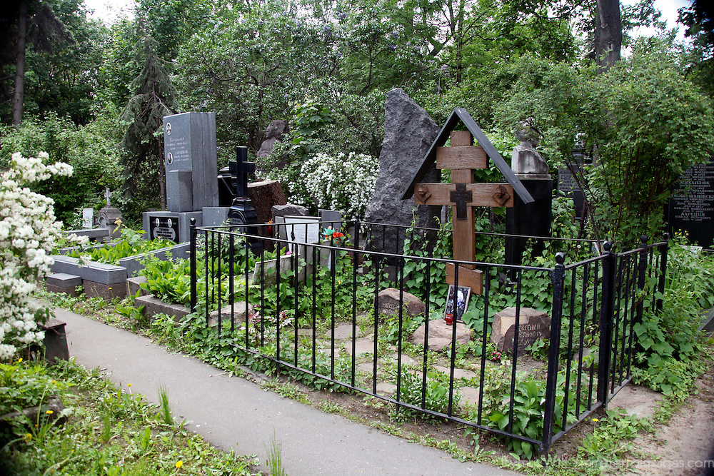 Europe, Russia, Moscow. traditional Russian grave with wooden cross at Novodevichy Convent Cemetery.