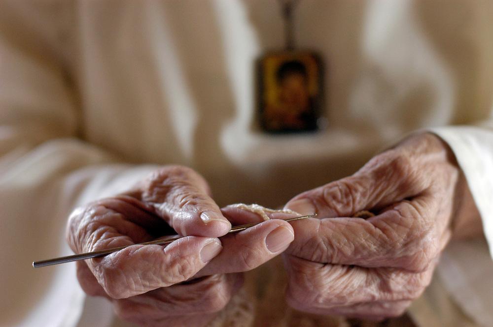 Caguas, Puerto Rico- A nun works on a hand made table cloth for an altar.