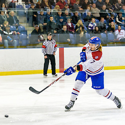 KINGSTON, - Apr 6, 2016 -  Ontario Junior Hockey League game action between Trenton Golden Hawks and Kingston Voyageurs. Game 4 of the North East Championship series.  at the Invista Centre, ON. Josh Hardiman #7 of the Kingston Voyageurs shoots the puck during the second period. (Photo by Ian Dixon / OJHL Images)