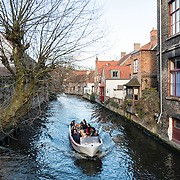 "Sometimes called ""The Venice of the North,"" the historic Flemish city of Bruges has canals running through the old town. Before the water access became silted up, Bruges was a major commercial port."