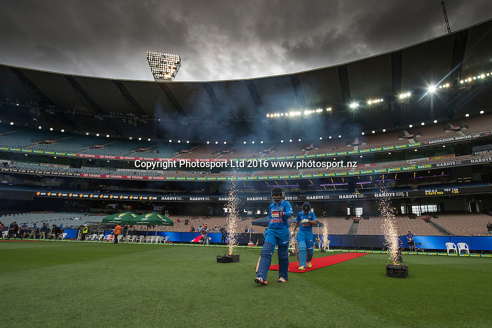 Dense Dark Clouds around the MCG as the Indian opening batters walk in during the Women's Twenty20 match between Australia and India at the MCG in Melbourne, Australia. Friday 29 January 2016. Copyright photo: Raghavan Venugopal / www.photosport.nz