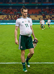 NANNING, CHINA - Thursday, March 22, 2018: Wales' hat-trick hero walks off the pitch with the match-ball stuffed under his shirt after the opening match of the 2018 Gree China Cup International Football Championship between China and Wales at the Guangxi Sports Centre. (Pic by David Rawcliffe/Propaganda)