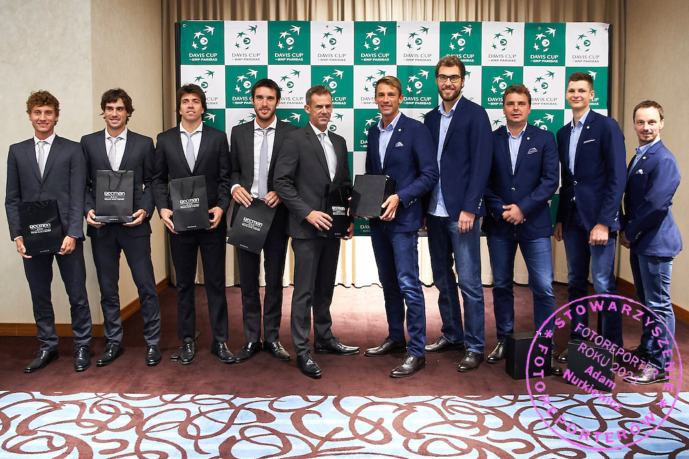 GDANSK, POLAND - 2016 MARCH 02: (L-R) Renzo Olivo and Guido Pella and Carlos Berlocq and Leonardo Mayer and captain Daniel Orsanic all from Argentina and Lukasz Kubot and Jerzy Janowicz and Marcin Matkowski and Hubert Hurkacz and Radoslaw Szymanik - captain national team all from Poland pose to photo while official dinner two days before the Davies Cup / World Group 1st round tennis match between Poland and Argentina at Ergo Arena on March 2, 2016 in Gdansk, Poland<br /> <br /> Picture also available in RAW (NEF) or TIFF format on special request.<br /> <br /> Any editorial, commercial or promotional use requires written permission.<br /> <br /> Mandatory credit:<br /> Photo by &copy; Adam Nurkiewicz / Mediasport