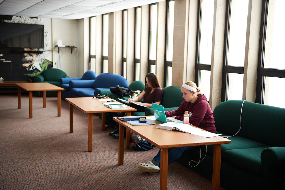 Activity; Studying; Buildings; Laux Hall; Dorm; Location; Inside; Objects; Computer; notepad; People; Student Students; Woman Women; Type of Photography; Candid; UWL UW-L UW-La Crosse University of Wisconsin-La Crosse; Winter; February