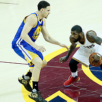09 June 2017: Golden State Warriors guard Klay Thompson (11) defends on Cleveland Cavaliers guard Kyrie Irving (2) during the Cleveland Cavaliers 137-11 victory over the Golden State Warriors, in game 4 of the 2017 NBA Finals, at  the Quicken Loans Arena, Cleveland, Ohio, USA.