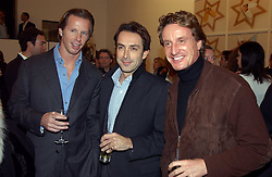 Left to right, CHRISTOPHER GETTY, BOBBY HASHEMI and TIM ATTIAS at an exhibition of photographs by Matthew Mellon entitled Famous Feet - featuring well known people wearing shoes from Harrys of London, held at Hamiltons Gallery, Carlos Place, London on 22nd November 2004.<br /><br />NON EXCLUSIVE - WORLD RIGHTS