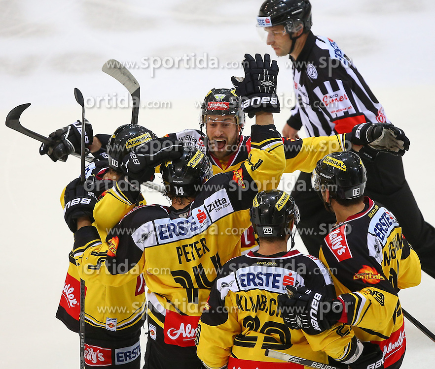 29.03.2015, Albert Schultz Eishalle, Wien, AUT, EBEL, UPC Vienna Capitals vs EHC Liwest Linz, Playoff, im Bild Torjubel Matt Watkins (UPC Vienna Capitals), Patrick Peter (UPC Vienna Capitals), Rafael Rotter (UPC Vienna Capitals), Sven Klimbacher (UPC Vienna Capitals) und Kenny Magowan (UPC Vienna Capitals) // during the Erste Bank Icehockey League playoff match between UPC Vienna Capitals and EHC Liwest Linz at the Albert Schultz Ice Arena, Vienna, Austria on 2015/03/29. EXPA Pictures © 2015, PhotoCredit: EXPA/ Thomas Haumer