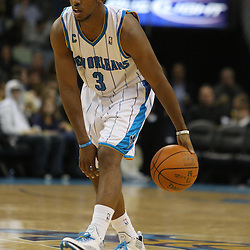 Dec 30, 2009; New Orleans, LA, USA;  New Orleans Hornets guard Chris Paul (3) controls the ball against the Miami Heat during a game at the New Orleans Arena. The Hornets defeated the Heat 95-91. Mandatory Credit: Derick E. Hingle-US PRESSWIRE