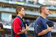 Ahead of his MLB debut, rookie starting pitcher Kyle Gibson #44 (left) and Caleb Thiebar #56 of the Minnesota Twins stand during the national anthem before a game against the Kansas City Royals on June 27, 2013 at Target Field in Minneapolis, Minnesota.  The Twins defeated the Royals 3 to 1.  Photo by Ben Krause