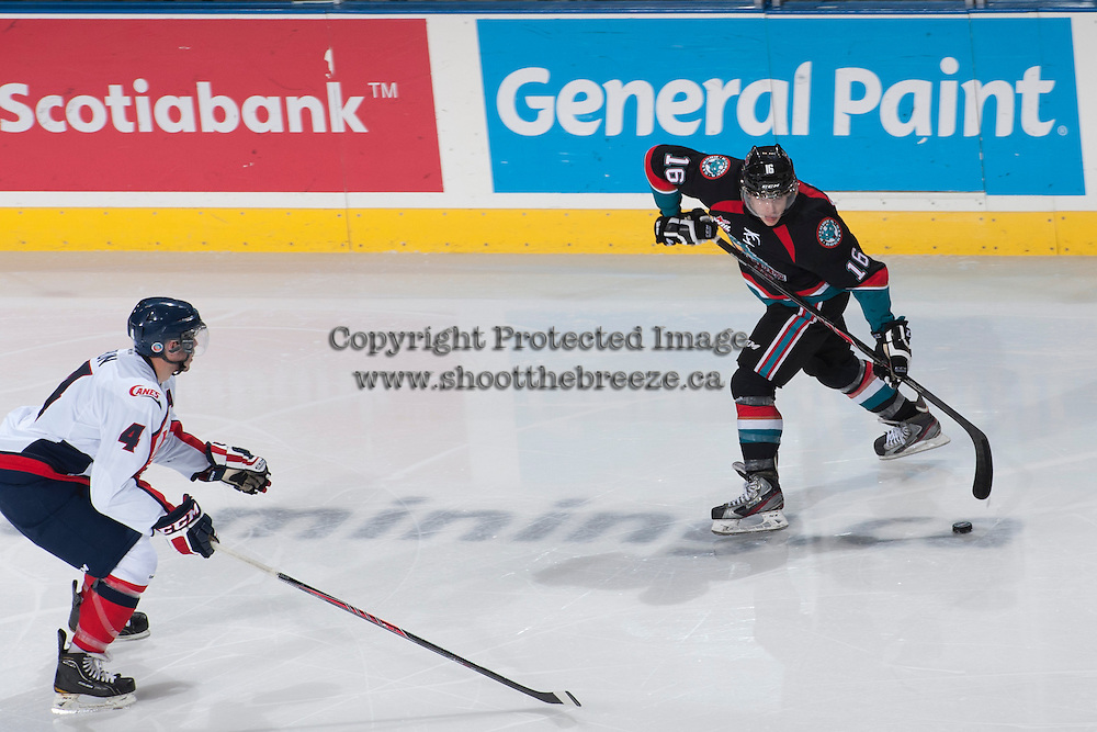 KELOWNA, CANADA, OCTOBER 16 - Kris Schmidli #16 of the Kelowna Rockets takes a shot against the Lethbridge Hurricanes  on Wednesday, October 16, 2013 at Prospera Place in Kelowna, British Columbia (photo by Marissa Baecker/Getty Images)***Local Caption***