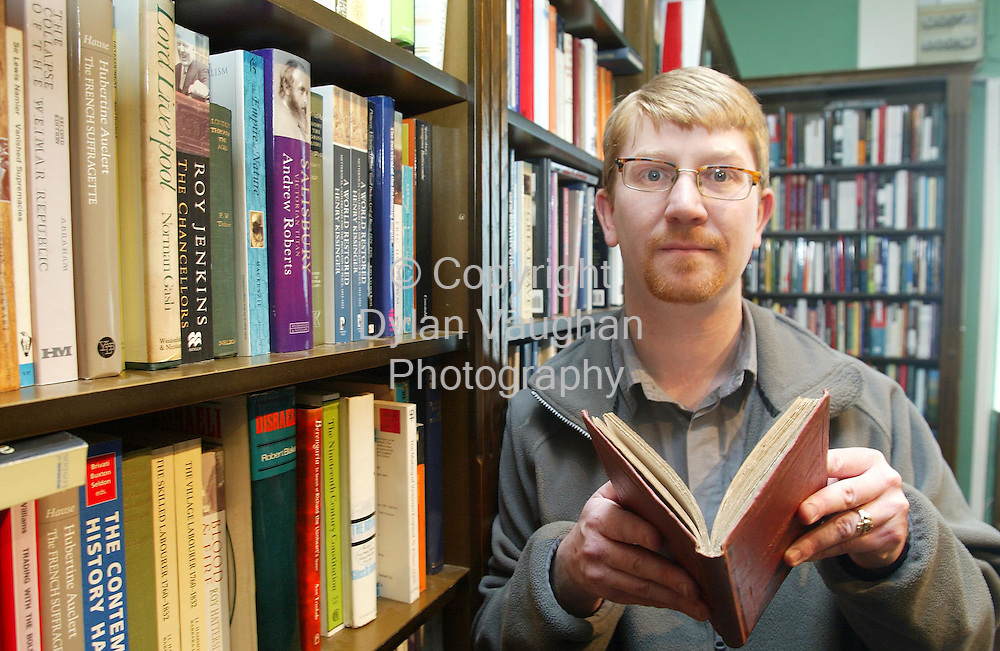 1/3/2002 Irish Examiner ref Declan HAsset.John Heddon of Tall Stories book shop in Kilkenny pictured in the shop with a 1st edition copy oHunting Skeyches by Anthony Trollope..Picture Dylan Vaughan