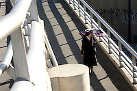 A nun walks on a new pedestrian bridge in downtown Bogotá on Thursday, September 28, 2006. Bogotá has always had a high rate of pedestrian fatalities so as part of the revitalization of the city bridges have been built of many busy intersections in an attempt to make the city safer. (Photo/Scott Dalton).