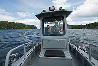 Dept of Safety Marine Patrol Sergeant Seth Alie and Captain Tim Dunleavy head out from Glendale past Lockes Island during their patrol on Lake Winnipesaukee Thursday afternoon.  (Karen Bobotas/for the Laconia Daily Sun)