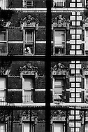 New York City July 4th, 1988.  A brownstone as seen from behind the window pane of an apartment across the street.