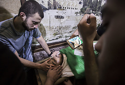 September 29, 2018 - Gaza City, The Gaza Strip, Palestine - (EDITORS NOTE: Image depicts death.) Palestinians touch the forehead of Muhammad Shakta during his funeral ceremony. Muhammad Shakta was killed by Israeli soldiers at the ''Great March of Return'' demonstration in Gaza. (Credit Image: © Mahmoud Issa/SOPA Images via ZUMA Wire)