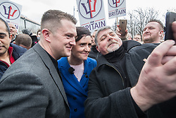 © Licensed to London News Pictures . 24/03/2018. Birmingham, UK. Former EDL leader TOMMY ROBINSON and For Britain party leader ANNE-MARIE WATERS at a Football Lads Alliance demonstration against Islam and extremism in Birmingham City Centre . Offshoot group, The True Democratic Football Lads Alliance, also hold a separate demonstration . Photo credit: Joel Goodman/LNP
