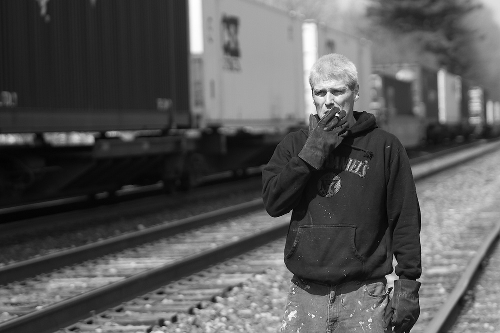 A portrait of Brian Croft on the tracks where he collects metal. (© Matt Wright 2011)