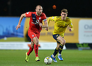 York City midfielder Russell Penn and Oxford United Midfielder Josh Ruffels during the Sky Bet League 2 match between Oxford United and York City at the Kassam Stadium, Oxford, England on 1 March 2016. Photo by Adam Rivers.