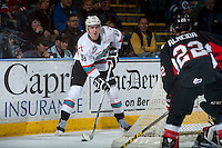 KELOWNA, CANADA - MARCH 9: Tate Coughlin #18 of Kelowna Rockets handles the puck behind the net against the Prince George Cougars on March 9, 2016 at Prospera Place in Kelowna, British Columbia, Canada.  (Photo by Marissa Baecker/Shoot the Breeze)  *** Local Caption *** Tate Coughlin;