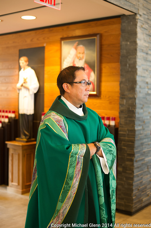 July 12 2015, Jackson USA // Fr. Sheldon Amasa celebrates mass at St Aloysius. Fr Amasa celebrates 25 years in the priesthood // Michael Glenn for The Monitor
