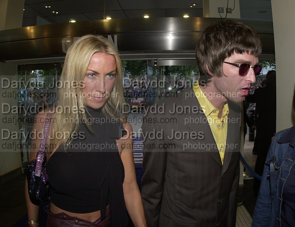 Meg Mathews and Noel Gallagher. Snatch Premiere. Odeon Leicester Sq. London. 23 Augusty 2000. <br /> &copy; Copyright Photograph by Dafydd Jones 66 Stockwell Park Rd. London SW9 0DA Tel 020 7733 0108 www.dafjones.com