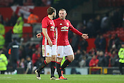 Wayne Rooney Forward of Manchester United chats with Daley Blind Midfielder of Manchester United with a cut face after the EFL Cup Quater-Final between Manchester United and West Ham United at Old Trafford, Manchester, England on 30 November 2016. Photo by Phil Duncan.