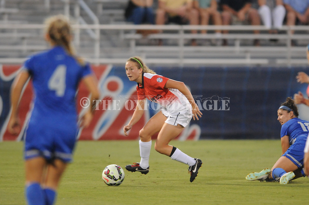 Ole Miss' Addie Forbus (25) is tripped up by Memphis' Marissa Duguay (18) at the Ole Miss Soccer Stadium in Oxford, Miss. on Sunday, September 7, 2014.  The match ended in a 1-1 draw in double overtime..