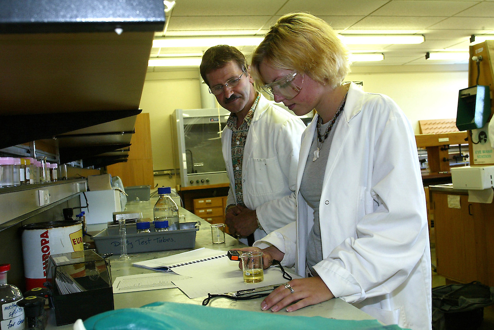 A trainee lab technician receiving tuition from her teacher, New Plymouth, New Zealand, March 03, 2004. Credit:SNPA / Rob Tucker