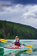 Kayaking on Beaver Lake near Whitefish, Montana, USA model released