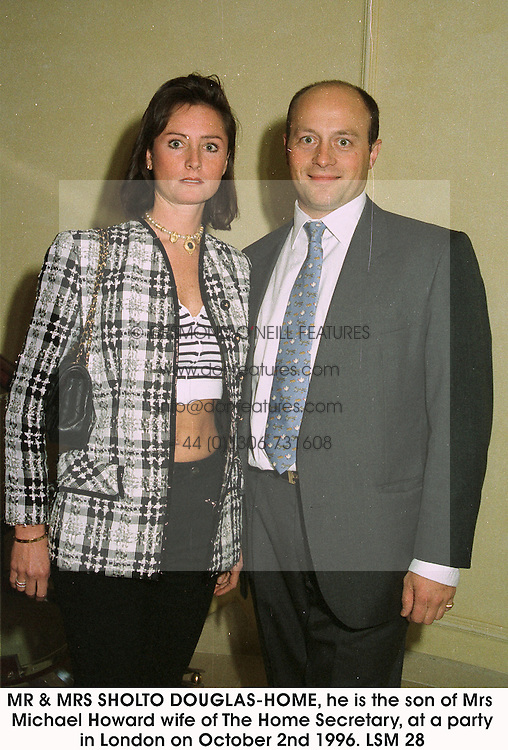 MR & MRS SHOLTO DOUGLAS-HOME, he is the son of Mrs Michael Howard wife of The Home Secretary, at a party in London on October 2nd 1996.LSM 28