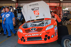 June 25, 2011; Sonoma, CA, USA;  A crew member works on the car of NASCAR Sprint Cup Series driver Joey Logano (not pictured) in the garage during practice for the Toyota/Save Mart 350 at Infineon Raceway.