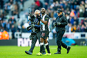 Jetro Willems (#15) of Newcastle United applauds the Newcastle United fans following the Premier League match between Newcastle United and Manchester City at St. James's Park, Newcastle, England on 30 November 2019.