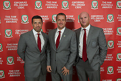 CARDIFF, WALES - Monday, October 8, 2012: Wales' head of fitness and science Ryland Morgans, goalkeeping coach Martyn Margetson and assistant coach John Hartson during the FAW Player of the Year Awards Dinner at the National Museum Cardiff. (Pic by David Rawcliffe/Propaganda)