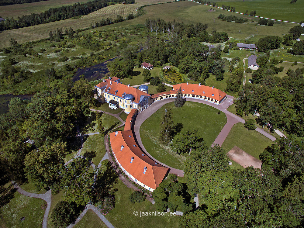 Kiltsi manor in Estonia. Aerial view, rooftop, green trees. School. Old building, castle.
