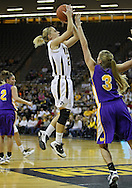 December 22 2010: Iowa guard Kamille Wahlin (2) puts up a shot over Northern Iowa guard Rachel Madrigal (3) during the first half of an NCAA college basketball game at Carver-Hawkeye Arena in Iowa City, Iowa on December 22, 2010. Iowa defeated Northern Iowa 75-64.