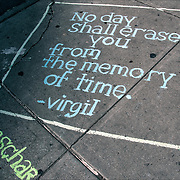 "Honschar - Chalk Street Artist Quote from Virgil ""No day shall erase you from the memory of Time"" on slide walk near ground zero on 9/11/12"