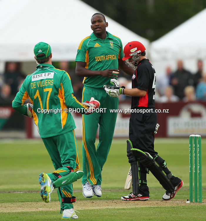 South African Lonwabo Tsotsobe celebrates the wicket of Tom Latham with wicket keeper AB de Villiers. Canterbury Wizards v South Africa. International Twenty20 cricket match, Hagley Oval, Wednesday 15 February 2012. Photo : Joseph Johnson / photosport.co.nz