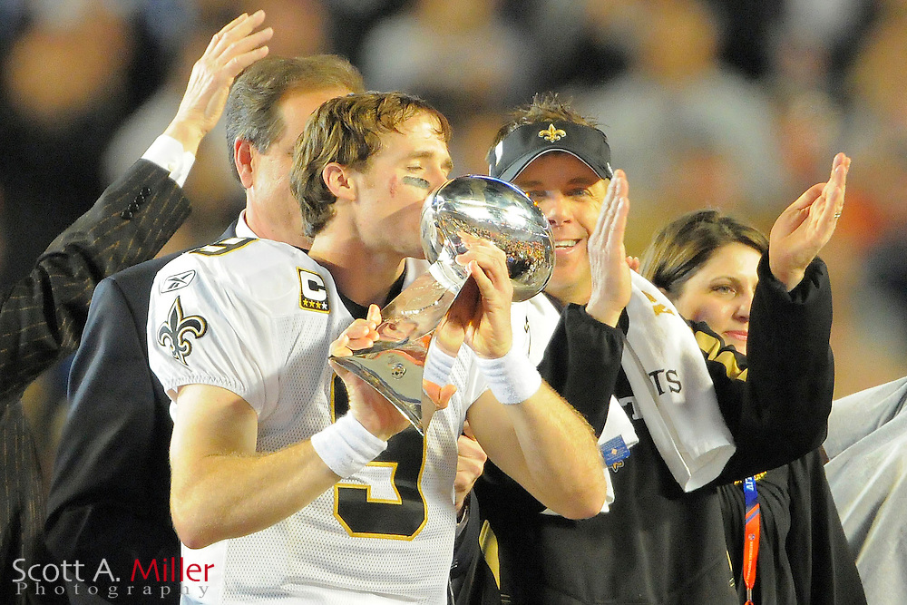 Feb 7, 2010; Miami, FL, USA; New Orleans Saints quarterback Drew Brees (9) kisses the Lombardi trophy after defeating the Indianapolis Colts 31-17 in Super Bowl XLIV at Sun Life Stadium. ©2010 Scott A. Miller