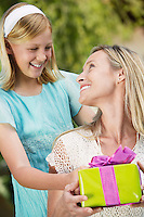 Girl Giving Mother Gift