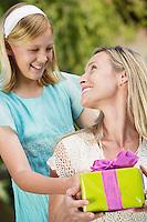 Girl Giving Mother Gift